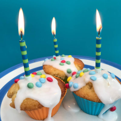 3 birthday cakes with candles