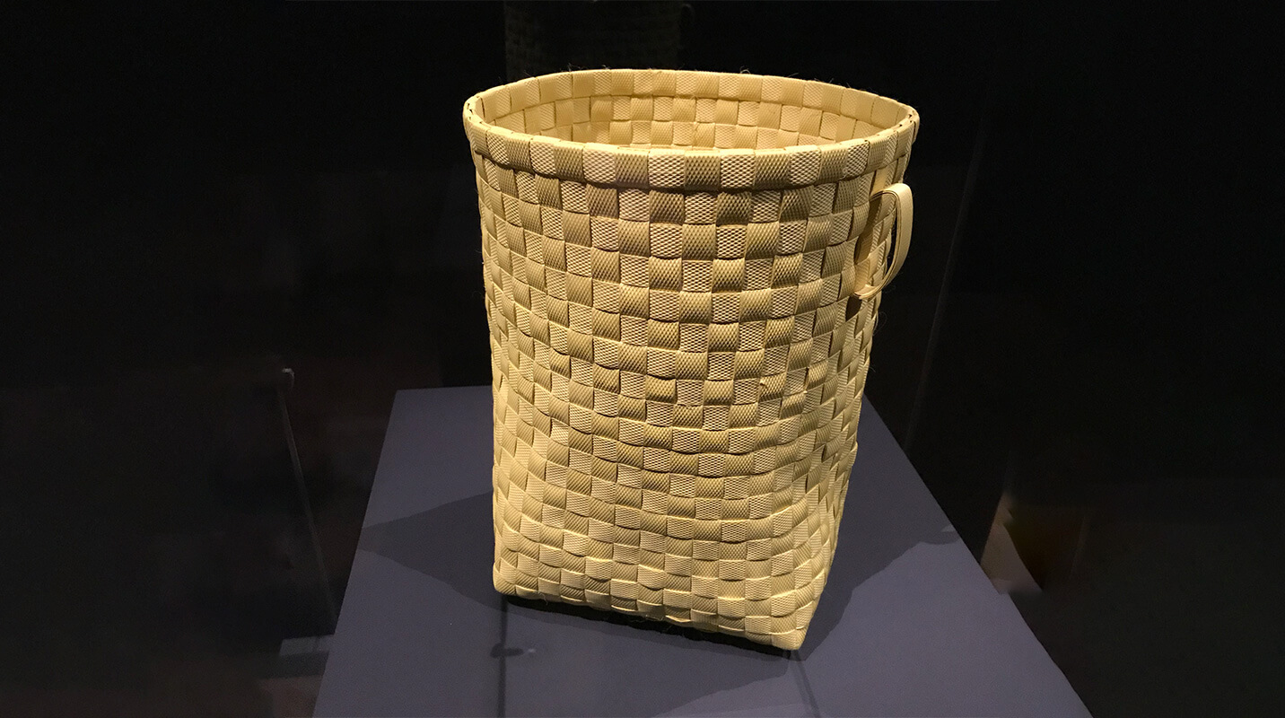 woven basket on pedestal